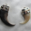 tsterling silver with 14kgold accent capped claws