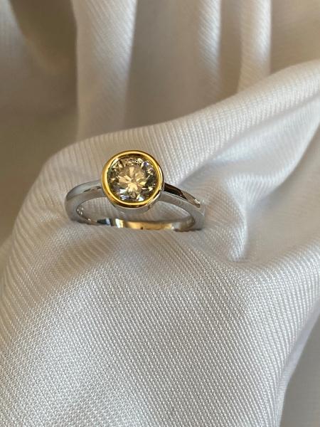 simple-18k-rimmed-diamond-engagement-ring