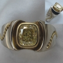14K White gold custom ring with 18k yellow gold and a 1.27ct Fancy Yellow Diamond