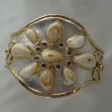 Sterling Silver /14K gold two toned Squash Blosssom style Elk Ivory Bracelet With Rhodolite Garnets