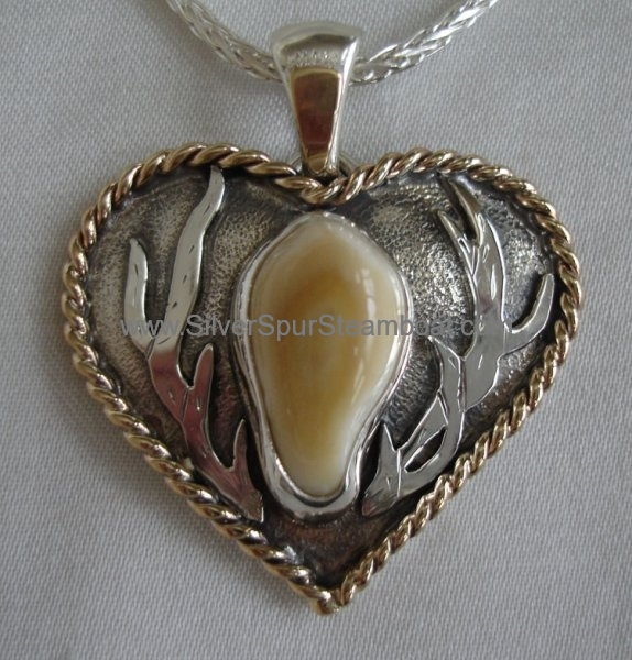 Heart Shaped Elk Tooth pendant with 14k twist trim and antlers