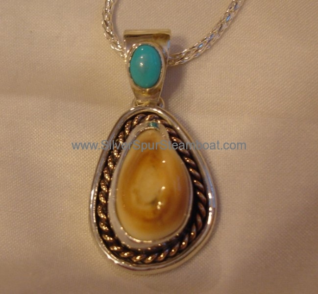 Sterling silver double trim 1 14k twist 1 smooth sterling trim with Turquoise on Bail elk tooth pendant