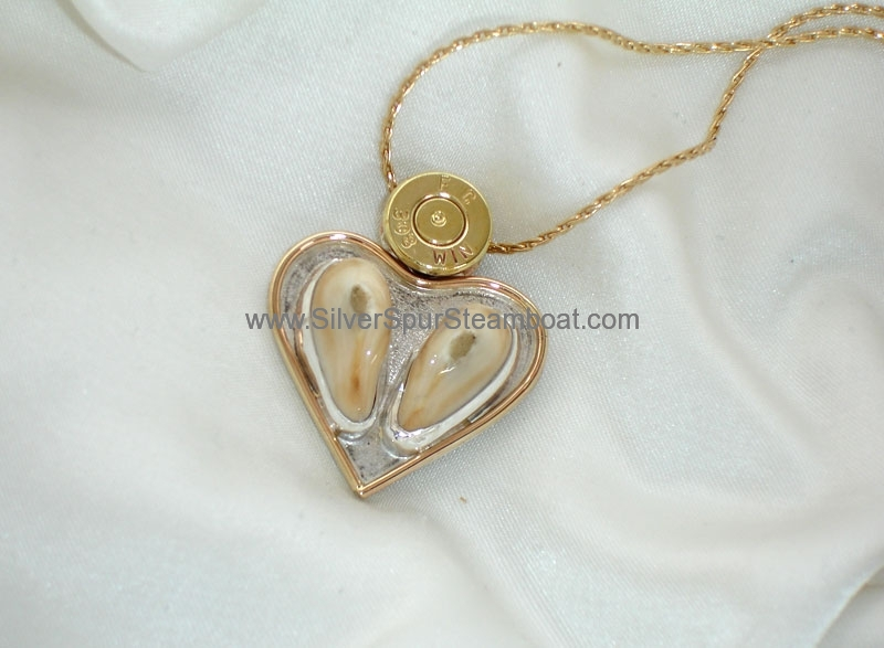 Heart shaped double Elk tooth pendant with 14k trim and bullet casing primer
