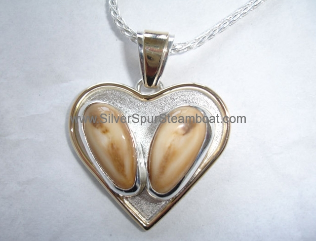 Heart shaped pendant with 14k Trimming