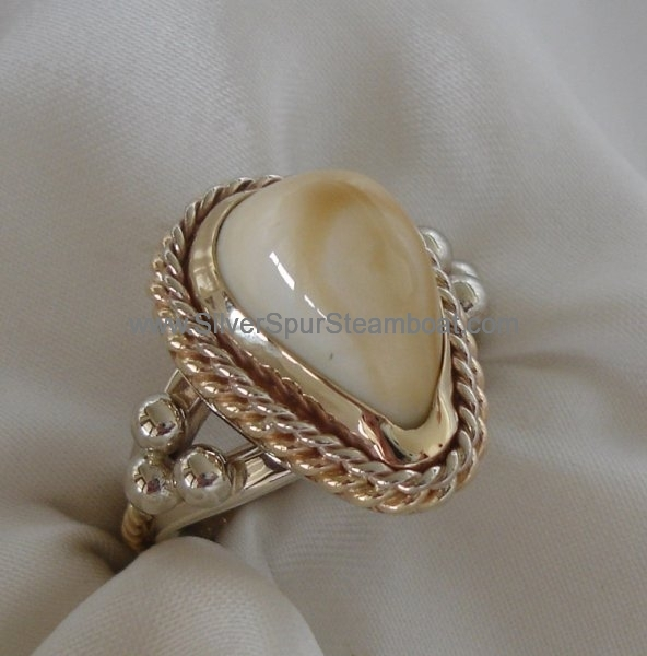 Fabricated double twist Elk tooth ring with beads and two toned Sterling Silver and 14k y gold