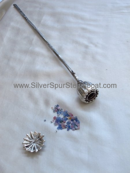 sterling silver poppy with natural sapphires